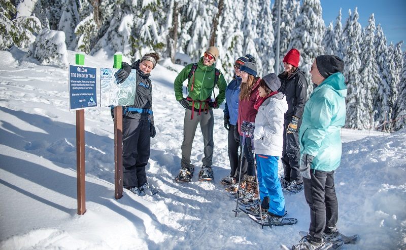 Group of people discussing about the crystal mountain's directions