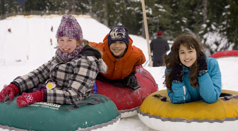 Children snow tubing at Mt Seymour in Vancouver